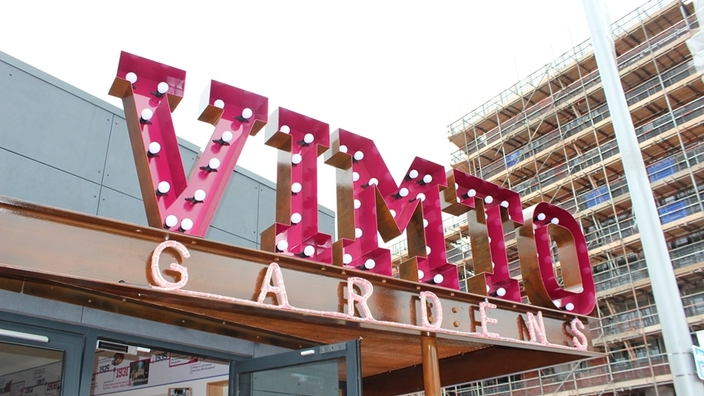 A sign of Vimto Gardens